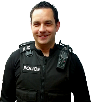 An image showing a smiling police officer